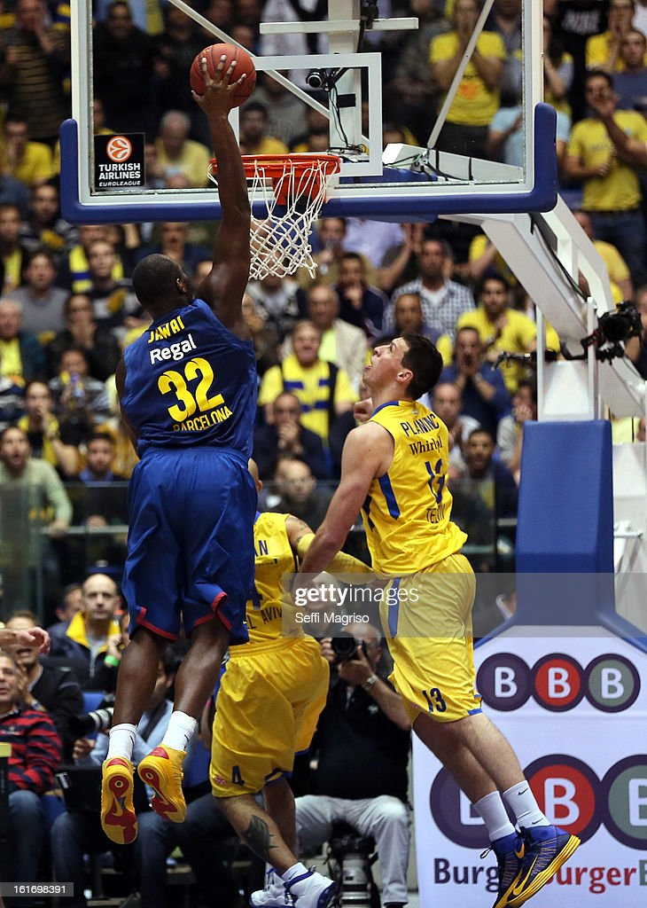 Nathan Jawai, #32 of FC Barcelona Regal competes with Darko Planinic, #13 of Maccabi Electra Tel Aviv during the 2012-2013 Turkish Airlines Euroleague Top 16 Date 7 between Maccabi Electra Tel Aviv v FC Barcelona Regal at Nokia Arena on February 14, 2013 in Tel Aviv, Israel.