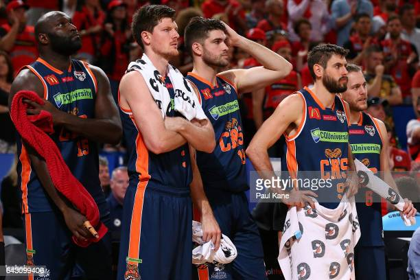 Nathan Jawai, Cameron Gliddon, Stephen Weigh, Jarrad Weeks of the Taipans and Damon Heuir of the Taipans look on from the bench during the game two...