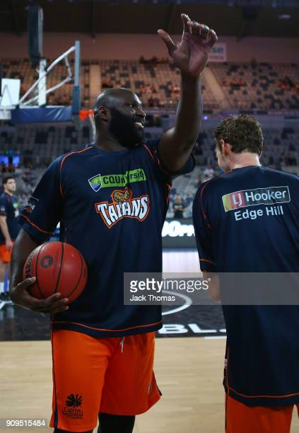 Nathan Jawai of the Cairns Taipans attempts to block Alex Loughton of the Cairns Taipans shot during warm ups prior to the round 14 NBL match between...
