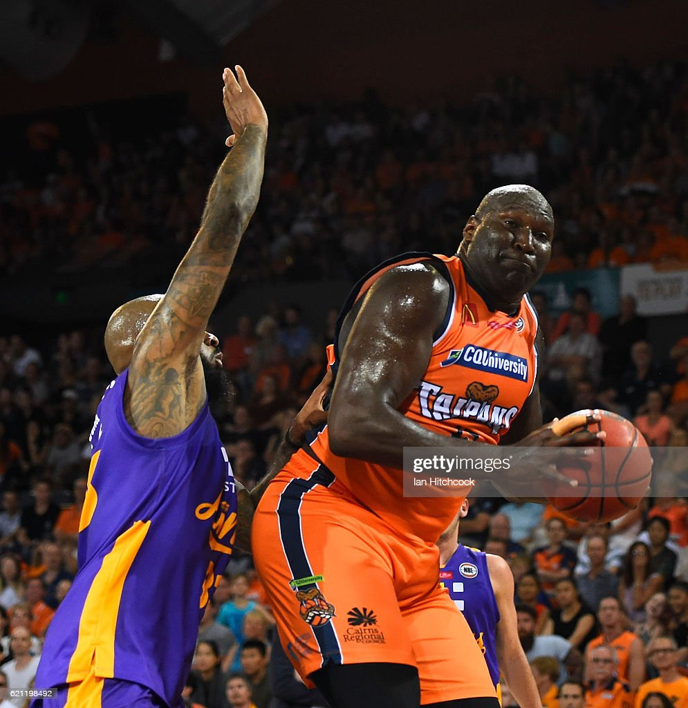 Nathan Jawai of the Taipans contests the ball ahead of Josh Powell