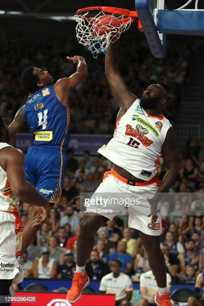 Nathan Jawai of the Taipans dunks the ball during the round three NBL match between the Brisbane Bullets and the Cairns Taipans at Nissan Arena, on...
