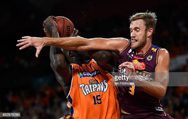 Nathan Jawai of the Taipans is blocked by Mitch Young of the Bullets during the round 17 NBL match between the Cairns Taipans and the Brisbane...