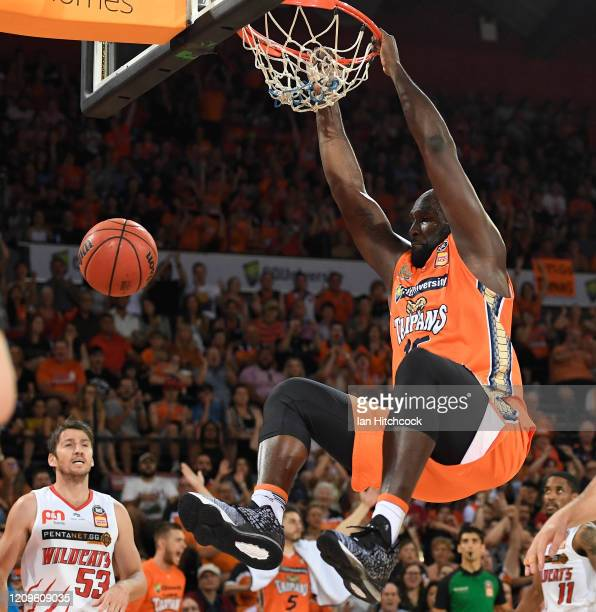Nathan Jawai of the Taipans slam dunks the ball during game two of the NBL Semi Final series between the Cairns Taipans and the Perth Wildcats at the...