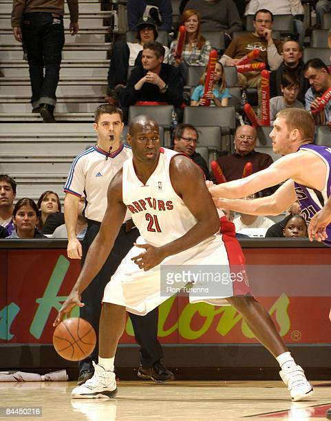 Nathan Jawai of the Toronto Raptors looks to back down defender Spencer Hawes of the Sacramento Kings during a game on January 25 2009 at the Air...