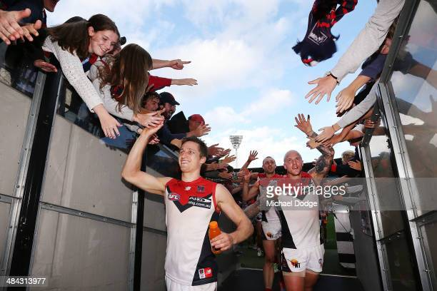 Nathan Jones and Jack Grimes of the Demons celebrate their win during the round four AFL match between the Carlton Blues and the Melbourne Demons at...