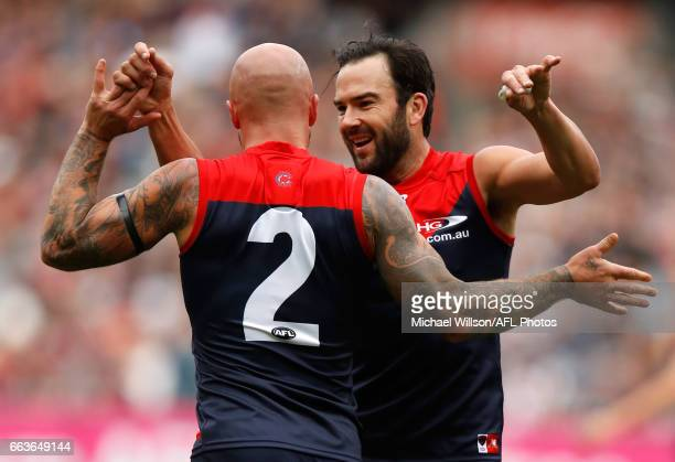 Nathan Jones and Jordan Lewis of the Demons celebrate during the 2017 AFL round 02 match between the Melbourne Demons and the Carlton Blues at the...