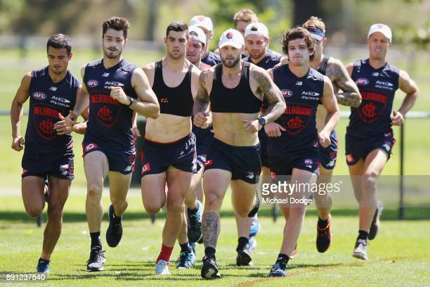 Nathan Jones leads as he sprints during a Melbourne Demons AFL training session at Gosch's Paddock on December 13 2017 in Melbourne Australia