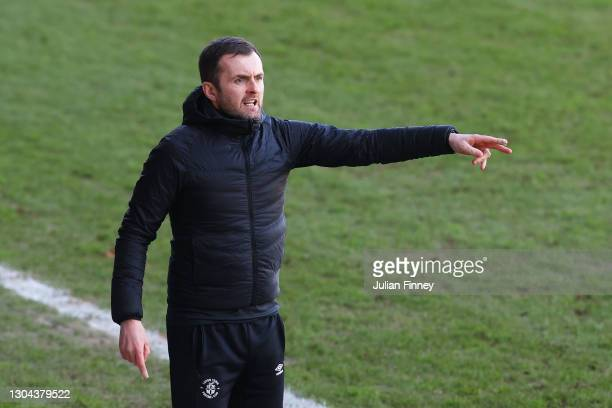 Nathan Jones, manager of Luton Town gives their team instructions during the Sky Bet Championship match between Luton Town and Sheffield Wednesday at...
