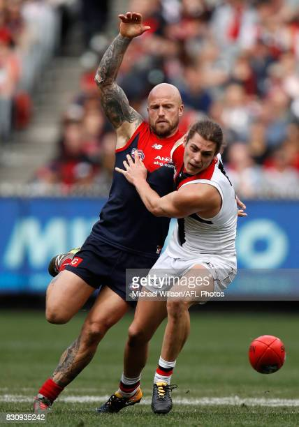 Nathan Jones of the Demons and Jack Steele of the Saints compete for the ball during the 2017 AFL round 21 match between the Melbourne Demons and the...