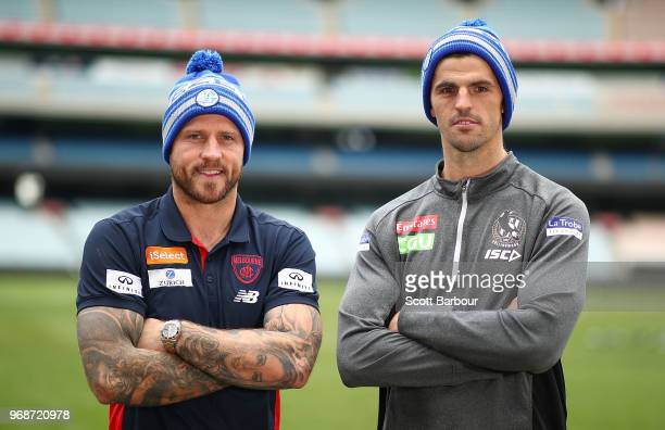 Nathan Jones of the Demons and Scott Pendlebury of the Magpies pose in Big Freeze 4 beanies during an AFL press conference at the Melbourne Cricket...