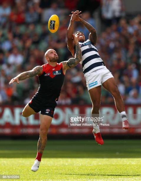 Nathan Jones of the Demons and Tim Kelly of the Cats compete for the ball during the 2018 AFL round 01 match between the Melbourne Demons and the...