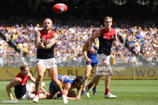 Nathan Jones of the Demons handballs during the AFL Preliminary Final match between the West Coast Eagles and the Melbourne Demons on September 22...