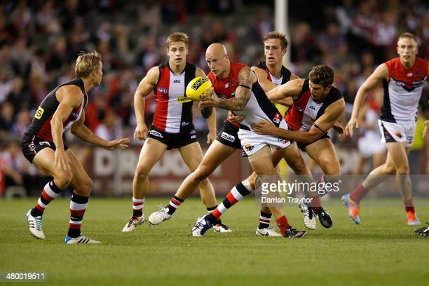 Nathan Jones of the Demons handballs during the round one AFL match between the St Kilda Saints and the Melbourne Demons at Etihad Stadium on March...