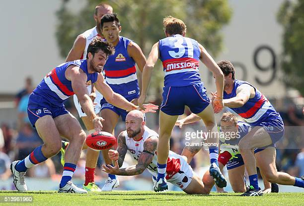 Nathan Jones of the Demons handballs out of a pack during the 2016 AFL NAB Challenge match between the Western Bulldogs and the Melbourne Demons at...