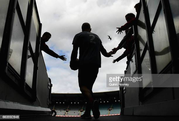 Nathan Jones of the Demons high fives fans as he comes out onto the field during the round two AFL match between the Melbourne Demons and the Carlton...