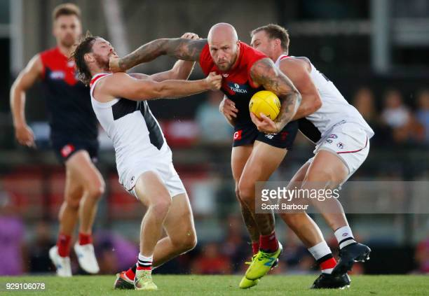 Nathan Jones of the Demons is tackled by Jack Steven of the Saints during the JLT Community Series AFL match between the Melbourne Demons and the St...