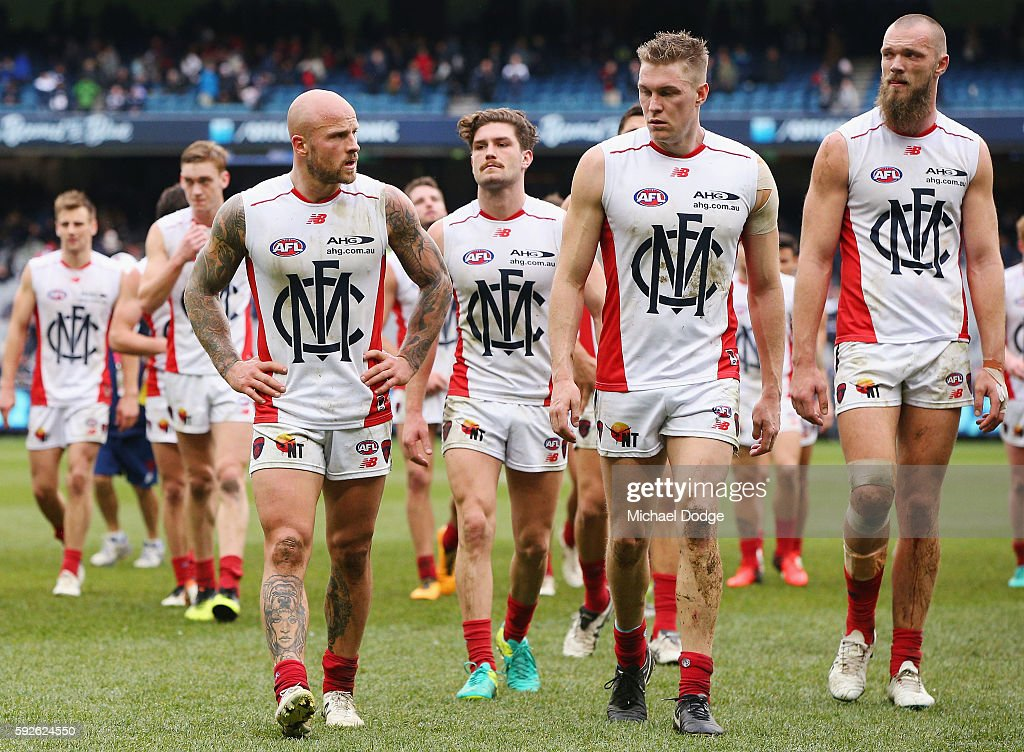 Nathan Jones of the Demons leads the team off after defeat during the round 22 AFL match between the Carlton Blues and the Melbourne Demons at Melbourne Cricket Ground on August 21, 2016 in Melbourne, Australia.