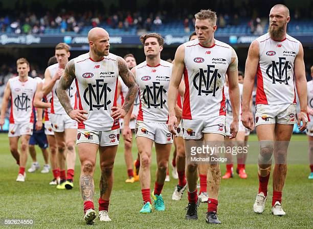 Nathan Jones of the Demons leads the team off after defeat during the round 22 AFL match between the Carlton Blues and the Melbourne Demons at...