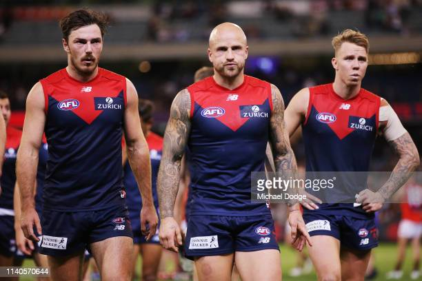 Nathan Jones of the Demons looks dejected after defeat during the round three AFL match between the Melbourne Demons and the Essendon Bombers at...