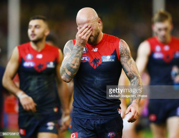 Nathan Jones of the Demons looks dejected after defeat during the 2018 AFL round five match between the Melbourne Demons and the Richmond Tigers at...