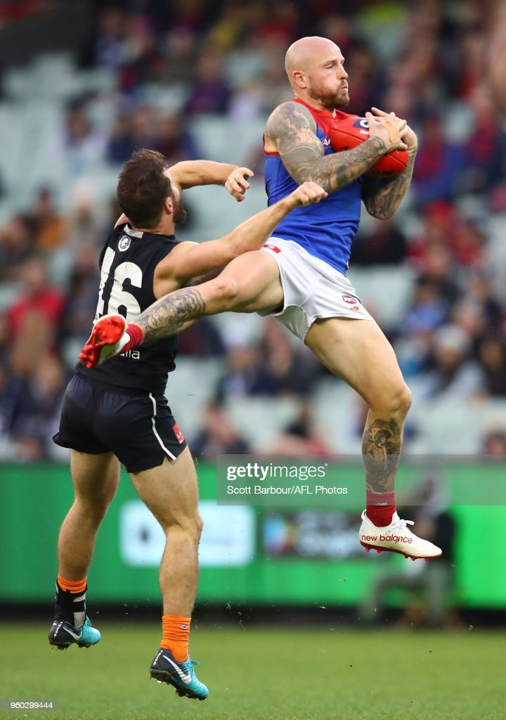 Nathan Jones of the Demons marks the ball over Matthew Wright of the Blues during the round nine AFL match between the Carlton Blues and the Melbourne Demons at Melbourne Cricket Ground on May 20, 2018 in Melbourne, Australia.