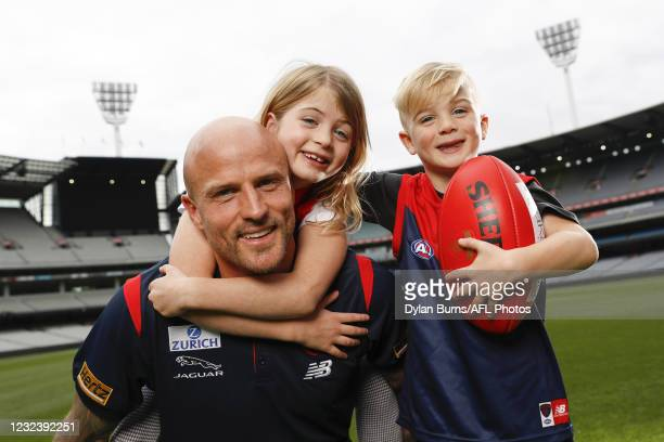 Nathan Jones of the Demons poses for a photo with his children, Bobby and Remy during the Melbourne Demons media opportunity at the Melbourne Cricket...