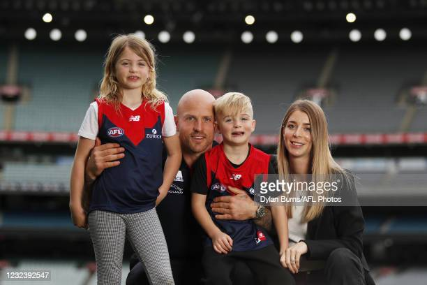 Nathan Jones of the Demons poses for a photo with his wife Jerri and children, Bobby and Remy during the Melbourne Demons media opportunity at the...