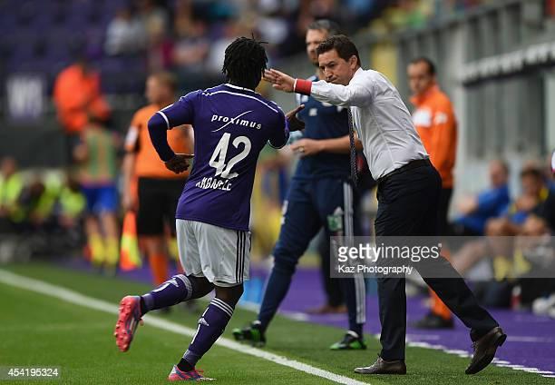 Nathan Kabasele of Anderlecht celebrates scoring his team's first goal with head coach Besnik Hasi during the Belgiun Jupilar League match between...