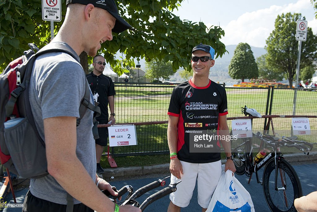 Nathan Killam of Canada (right) talks with fellow competitor Adam O'Meara of Canada during the Challenge Penticton Triathlon previews on August 24, 2013 in Penticton, British Columbia, Canada.