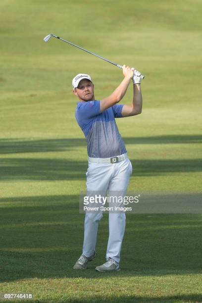 Nathan Kimsey of England plays an approach shot during the 58th UBS Hong Kong Golf Open as part of the European Tour on 09 December 2016 at the Hong...
