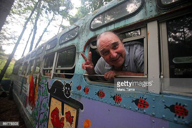 Nathan Koenig head of the Woodstock Museum stands in the old bus where his daughter was born as the 40th anniversary of the Woodstock music festival...