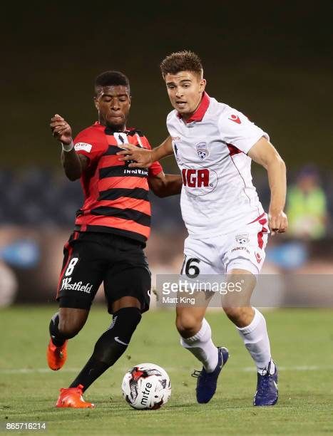 Nathan Konstandopoulos of United is challenged by Roly Bonevacia of the Wanderers during the FFA Cup Semi Final match between the Western Sydney...
