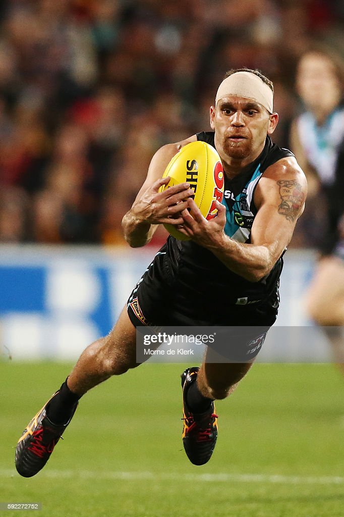 Nathan Krakouer of the Power takes a mark during the round 22 AFL match between the Port Adelaide Power and the Adelaide Crows at Adelaide Oval on August 20, 2016 in Adelaide, Australia.