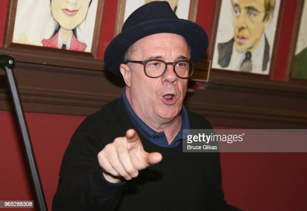 Nathan Lane makes a speech at the unveiling of Andrew Garfield's caricature honoring his performance in the play 'Angels in America' on Broadway at...