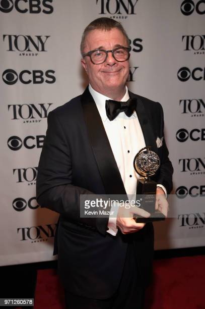 Nathan Lane poses with his award for Best Performance by an Actor in a Featured Role in a Play award for Angels in America backstage during the 72nd...
