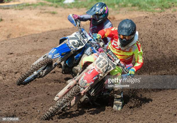 Nathan LaPorte and Brandon Scharer race through the corner during the Lucas Oil Pro Motorcross Tennessee National race at Muddy Creek Raceway in...