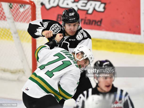 Nathan Lavoie of the BlainvilleBoisbriand Armada fights with Frederic Abraham of the ValdOr Foreurs during the QMJHL game at Centre d'Excellence...