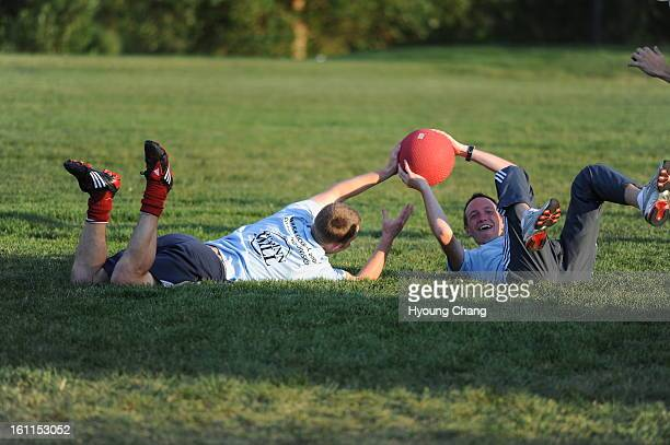 Nathan Lee left helped catching the ball by Thomas Parsons at City of Cuernavaca Park during World Adult Kickball Association's opening day with 14...