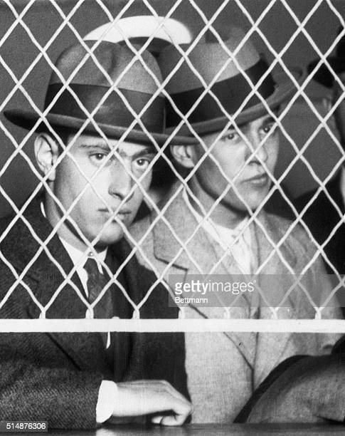 Nathan Leopold Jr and Richard Loeb confessed murderers of Robert Franks appear at a Chicago jail to be assigned to the quarters where they will...