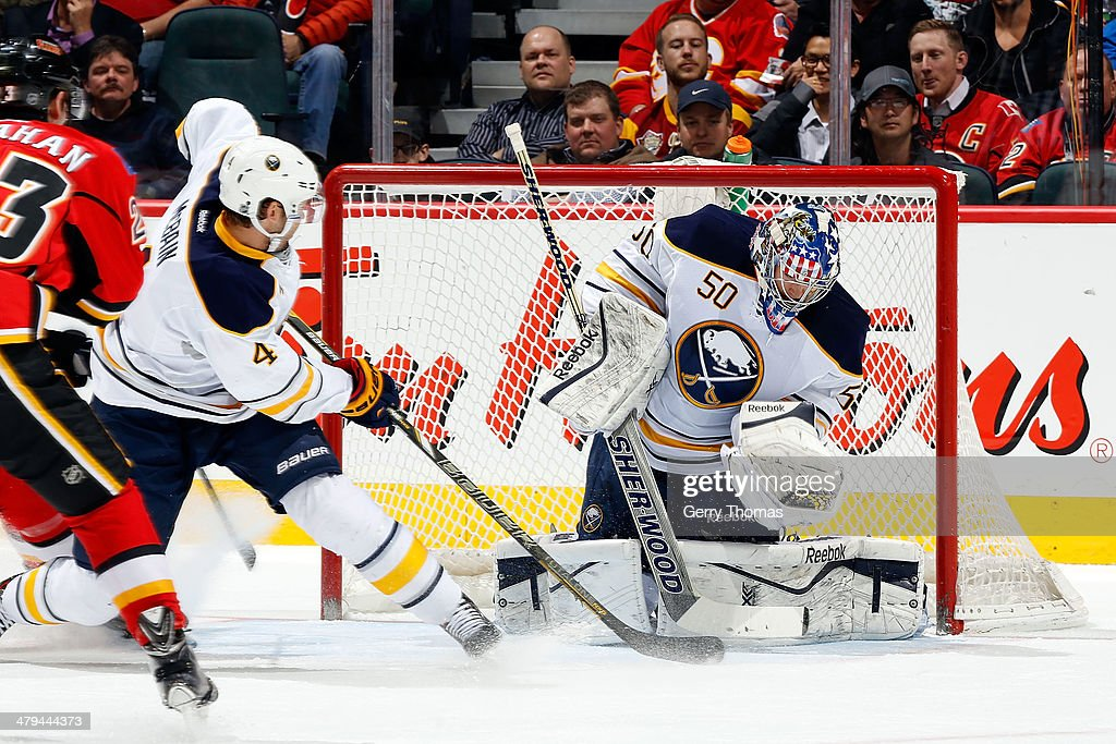 Nathan Lieuwen #50 of the Buffalo Sabres makes a save against the Calgary Flames at Scotiabank Saddledome on March 18, 2014 in Calgary, Alberta, Canada.