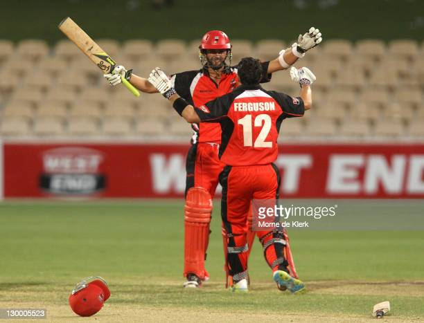 Nathan Lyon and Callum Ferguson of the Redbacks celebrates after winning the Ryobi One Day Cup match between the South Australia Redbacks and the...