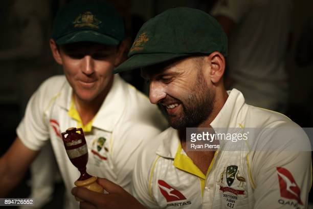 Nathan Lyon and Josh Hazlewood of Australia celebrate in the changerooms after Australia regained the Ashes during day five of the Third Test match...