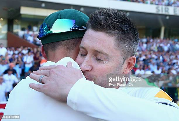 Nathan Lyon and Michael Clarke of Australia celebrate after claiming victory during day five of the First Test match between Australia and India at...