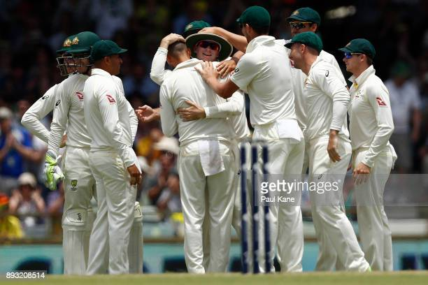 Nathan Lyon and Peter Handscomb of Australia celebrate the wicket of Dawid Malan of England during day two of the Third Test match during the 2017/18...
