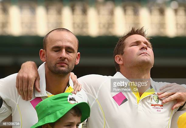 Nathan Lyon and Ryan Harris of Australia react during the national anthem during day one of the Fourth Test match between Australia and India at...