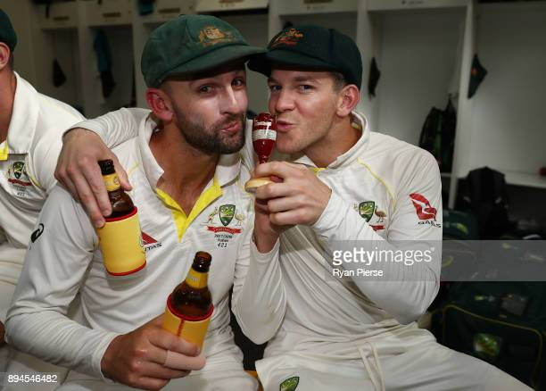 Nathan Lyon and Tim Paine of Australia of Australia celebrate in the changerooms after Australia regained the Ashes during day five of the Third Test...
