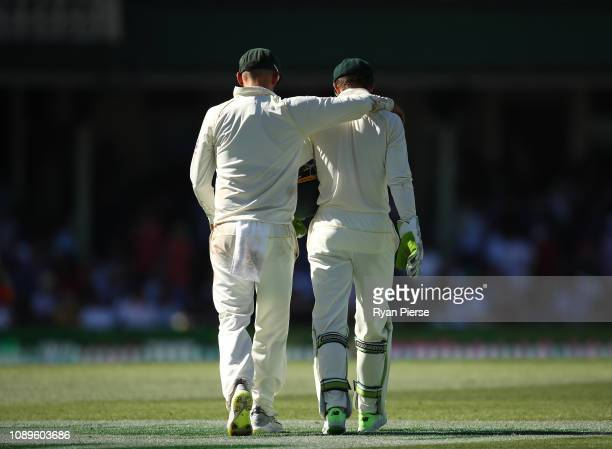 Nathan Lyon and Tim Paine of Australia walk together at a drinks break during day two of the Fourth Test match in the series between Australia and...