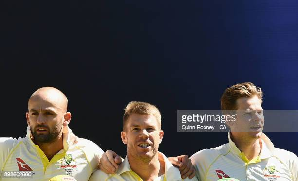 Nathan Lyon Dave Warner and Steve Smith of Australia stand for the national anthem during day one of the Fourth Test Match in the 2017/18 Ashes...
