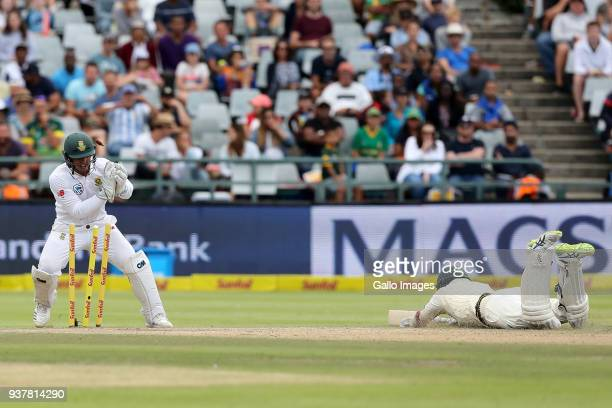 Nathan Lyon is runout by Quinten de Kock and Temba Bavuma during day 4 of the 3rd Sunfoil Test match between South Africa and Australia at PPC...