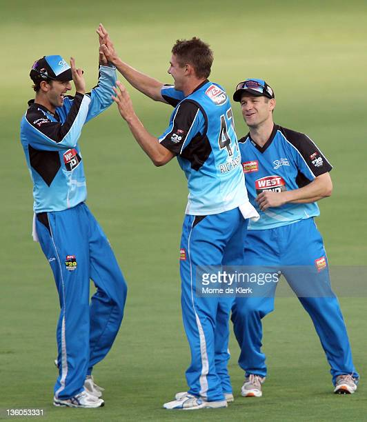 Nathan Lyon Kane Richardson and Daniel Harris of the Strikers celebrate after the dismissal of Shahid Afridi of the Renegades during the T20 Big Bash...